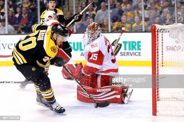 Riley Nash of the Boston Bruins takes a shot against Jimmy Howard of the Detroit Red Wings during the first period at TD Garden on December 23 2017...