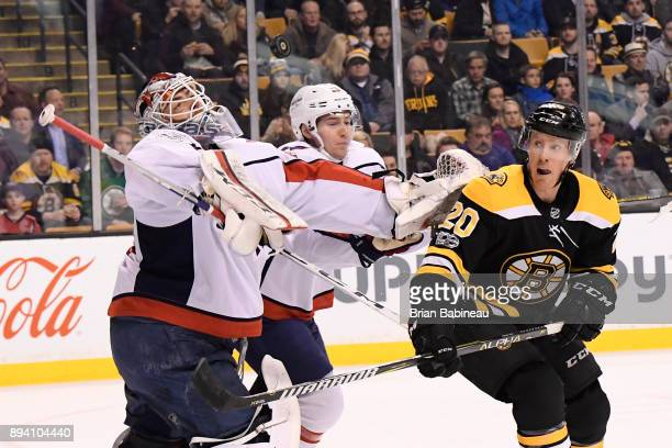 Riley Nash of the Boston Bruins watches a loose puck with Braden Holtby of the Washington Capitals at the TD Garden on December 14 2017 in Boston...