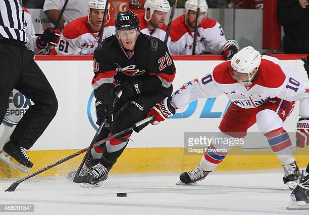 Riley Nash of the Carolina Hurricanes battles against Martin Erat of the Washington Capitals during their NHL game at PNC Arena on December 20, 2013...