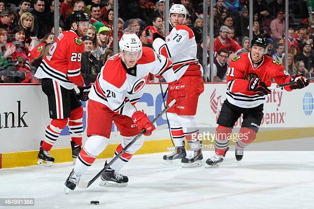 Riley Nash of the Carolina Hurricanes chases the puck ahead of Brett Bellemore and Bryan Bickell and Brad Richards of the Chicago Blackhawks during...