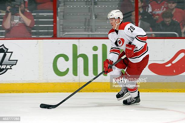 Riley Nash of the Carolina Hurricanes controls the puck in the first period during an NHL game against the Washington Capitals at Verizon Center on...