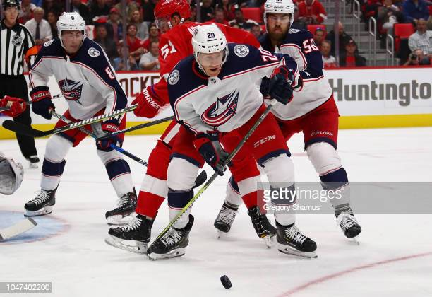 Riley Nash of the Columbus Blue Jackets battles for the puck while playing the Detroit Red Wings at Little Caesars Arena on October 4 2018 in Detroit...