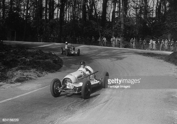 Riley of Hector Dobbs leading the MG Q type of Kenneth Evans Donington Park Leicestershire 1935 Artist Bill BrunellRiley 1458 cc Event Entry No 36...