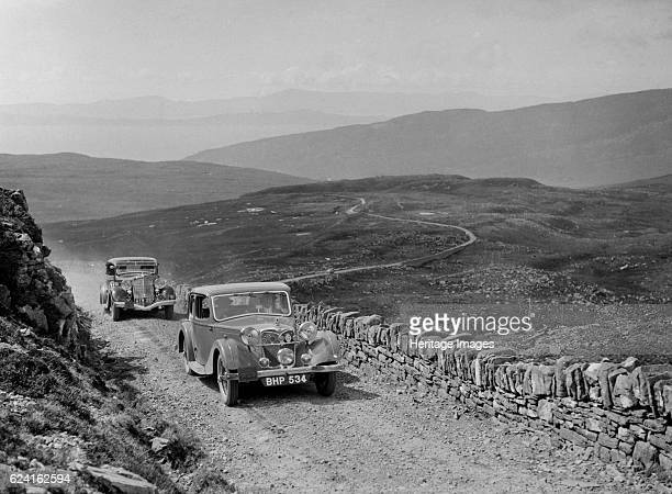Riley of Miss F Walker leading a Hudson Eight at the RSAC Scottish Rally 1936 Artist Bill BrunellRiley 1089 ccReg No BHP534 Entry No 45 Driver Walker...