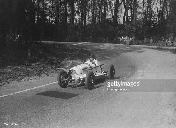 Riley offsetbodied single seater of Hector Dobbs racing at Donington Park Leicestershire 1935 Artist Bill BrunellRiley Offsetbodied singleseater 1458...