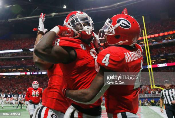 Riley Ridley of the Georgia Bulldogs celebrates with teammates after scoring a touchdown in the third quarter during the 2018 SEC Championship Game...
