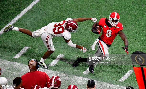 Riley Ridley of the Georgia Bulldogs is forced out of bounds by Levi Wallace of the Alabama Crimson Tide in the CFP National Championship presented...