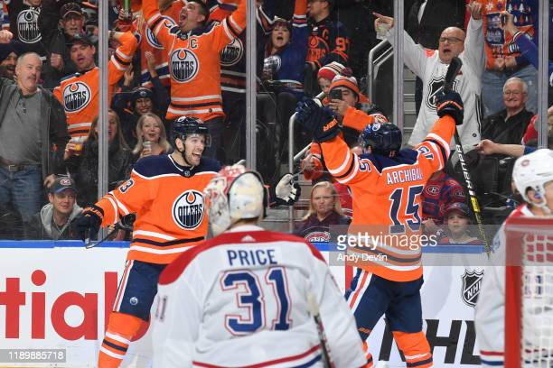 Riley Sheahan and Josh Archibald of the Edmonton Oilers celebrate after a goal during the game against the Montreal Canadiens on December 21 at...