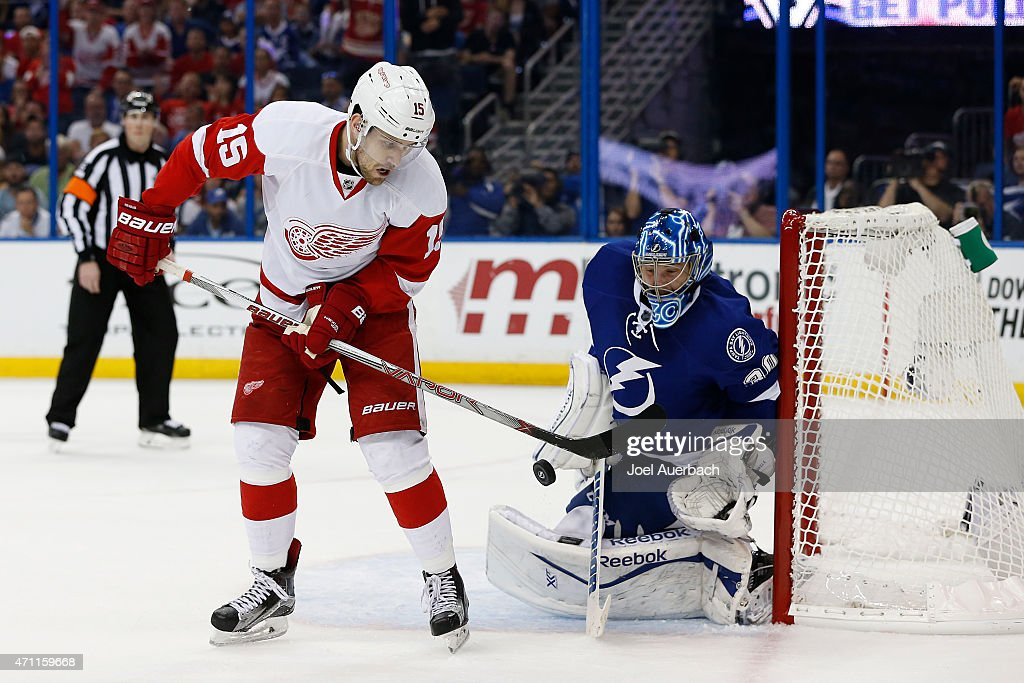 Riley Sheahan #15 of the Detroit Red Wings attempts to tip the puck past Goaltender Ben Bishop #30 of the Tampa Bay Lightning during the first period in Game Five of the Eastern Conference Quarterfinals during the 2015 NHL Stanley Cup Playoffs at the Amalie Arena on April 25, 2015 in Tampa, Florida. The Red Wings defeated the Lightning 4-0.
