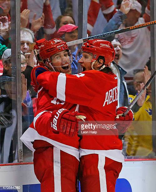 Riley Sheahan of the Detroit Red Wings celebrates after scoring a power play goal with teammate Justin Abdelkader during the third period in Game...