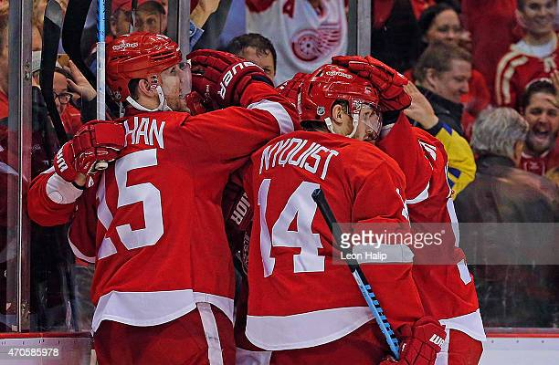 Riley Sheahan of the Detroit Red Wings celebrates with his teammates after scoring a third period goal against the Tampa Bay Lightning in Game Three...