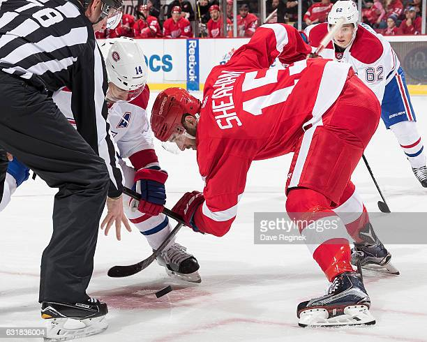 Riley Sheahan of the Detroit Red Wings faces off against Tomas Plekanec of the Montreal Canadiens during an NHL game at Joe Louis Arena on January 16...