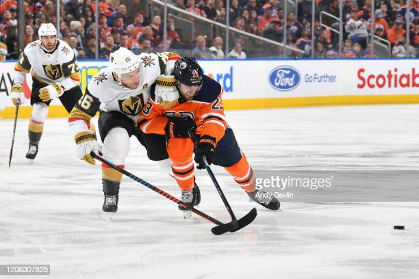 Riley Sheahan of the Edmonton Oilers battles for the puck against Paul Stastny of the Vegas Golden Knights on March 9 at Rogers Place in Edmonton...