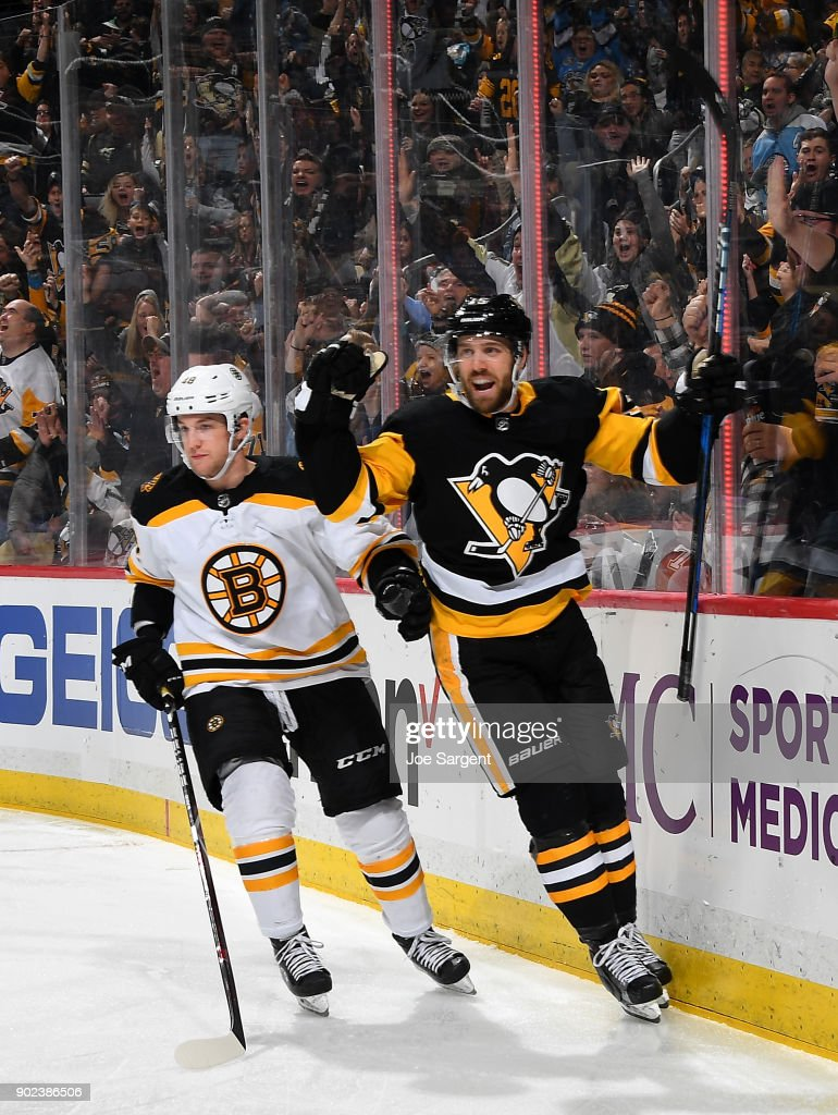 Riley Sheahan #15 of the Pittsburgh Penguins celebrates his goal in front of Matt Grzelcyk #48 of the Boston Bruins during the third period at PPG Paints Arena on January 7, 2018 in Pittsburgh, Pennsylvania.