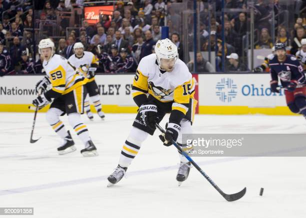 Riley Sheahan of the Pittsburgh Penguins controls the puck during first period of the game between the Columbus Blue Jackets and the Pittsburgh...