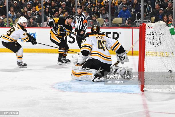 Riley Sheahan of the Pittsburgh Penguins scores past Tuukka Rask of the Boston Bruins during the third period at PPG Paints Arena on January 7 2018...
