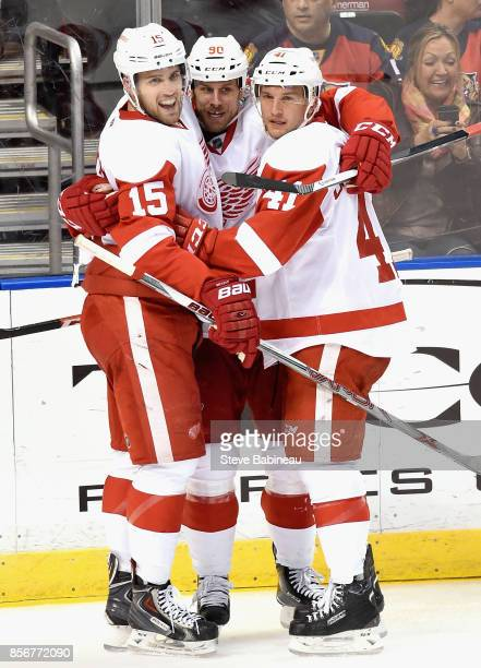 Riley Sheahan Stephen Weiss and Luke Glendening of the Detroit Red Wings play in a game against the Florida Panthers at BBT Center on January 27 2015...