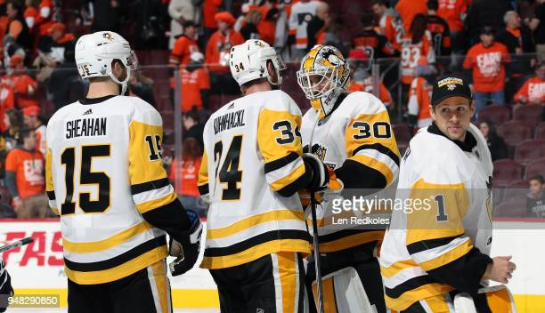Riley Sheahan Tom Kuhnhackl Matthew Murray and Casey DeSmith of the Pittsburgh Penguins celebrate after defeating the Philadelphia Flyers 51 in Game...