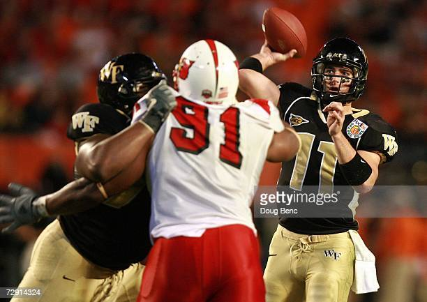 Riley Skinner of the Wake Forest Demon Deacons looks to pass against the Louisville Cardinals during the 2007 FedEx Orange Bowl at Dolphin Stadium on...