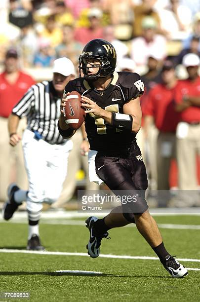 Riley Skinner of the Wake Forest Demon Deacons runs out of the pocket against the Maryland Terrapins at BB&T Field on September 22, 2007 in...