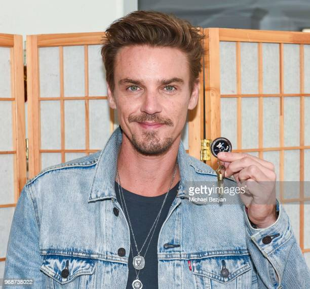 Riley Smith poses with TAP Medallion at Giveback Day at TAP The Artists Project on June 6 2018 in Los Angeles California
