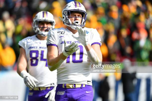 Riley Stapleton of the James Madison Dukes pumps up his teammates against the North Dakota State Bison during the Division I FCS Football...
