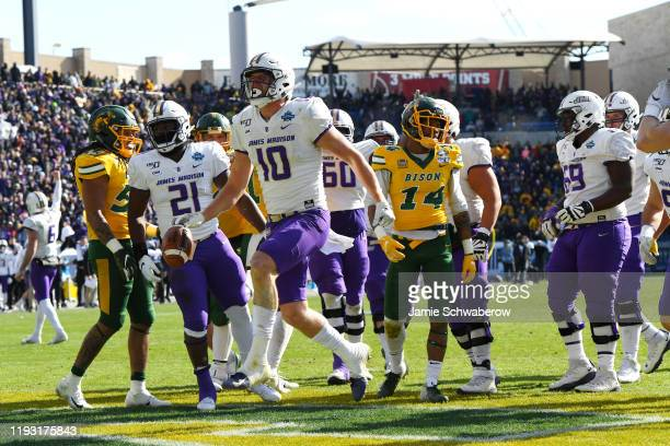Riley Stapleton of the James Madison Dukes scores on a touchdown reception against the North Dakota State Bison during the Division I FCS Football...