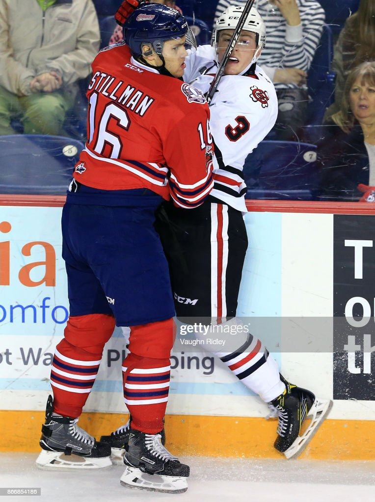 Riley Stillman #16 of the Oshawa Generals tangles with Ben Jones #3 of the Niagara IceDogs during an OHL game at the Meridian Centre on October 26, 2017 in St Catharines, Ontario, Canada.
