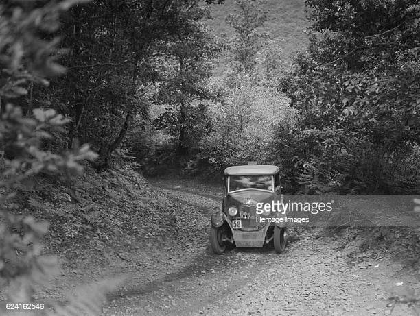 Riley taking part in a motoring trial c1930s Artist Bill BrunellRiley 1089 cc Vehicle Reg No GH1484 Event Entry No 58 Place Unidentified Trial