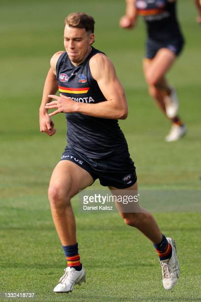 Riley Thilthorpe of the Crows runs during an Adelaide Crows AFL training session at Adelaide Oval on August 05, 2021 in Adelaide, Australia.