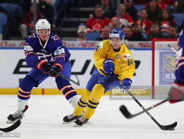 Riley Tufte of United States pursues Elias Pettersson of Sweden in the first period during the IIHF World Junior Championship at KeyBank Center on...