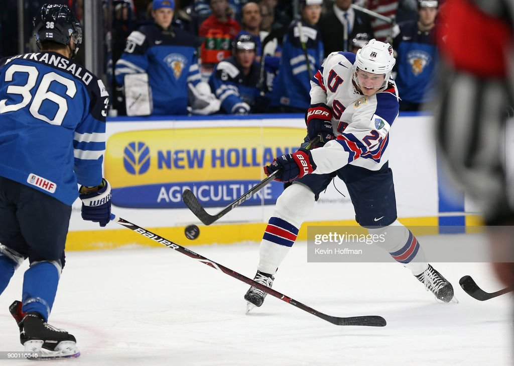 Riley Tufte #27 of United States takes a shot as Kasper Kotkansalo #36 of Finland defends in the first period during the IIHF World Junior Championship at KeyBank Center on December 31, 2017 in Buffalo, New York.