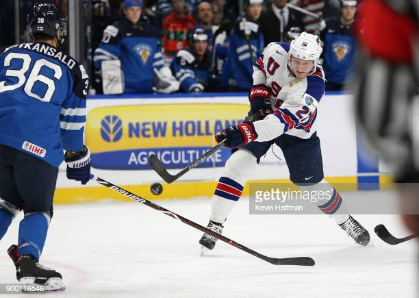 Riley Tufte of United States takes a shot as Kasper Kotkansalo of Finland defends in the first period during the IIHF World Junior Championship at...