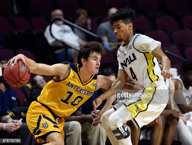 Riley Welch of the UC Irvine Anteaters drives the ball against Jojo Anderson of the Northern Arizona Lumberjacks during the 2017 Continental Tire Las...