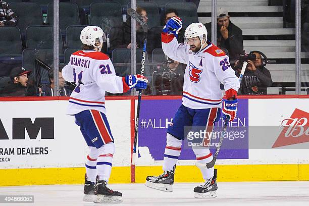 Riley Whittingham of the Spokane Chiefs celebrates after scoring against the Calgary Hitmen during a WHL game at Scotiabank Saddledome on October 29,...