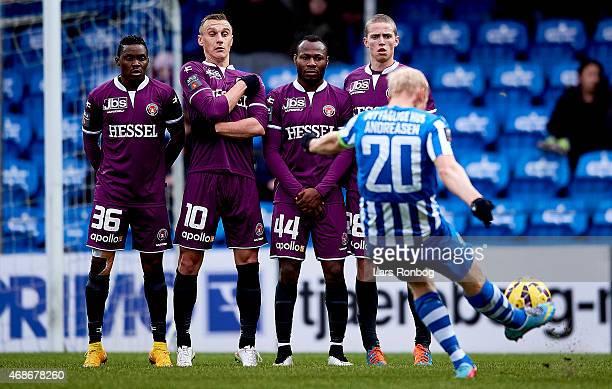 Rilwan Hassan Martin Pusic Sylvester Igboun and Andre Romer of FC Midtjylland defending against Hans Henrik Andreasen of Esbjerg FB during the Danish...