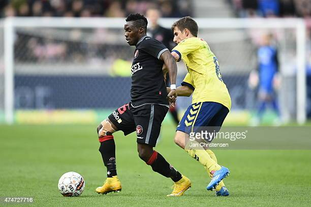 Rilwan Hassan of FC Midtjylland and Alexander Szymanowski of Brondby IF compete for the ball during the Danish Alka Superliga match between FC...