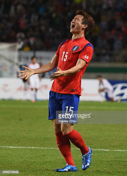 Rim Changwoo of South Korea celebrates celebrates the 10 win and claiming the gold medal after the Football Men's Gold Medal match between South...