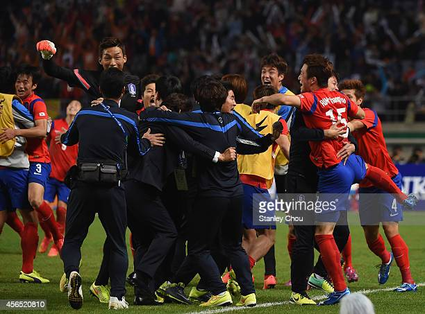 Rim Changwoo of South Korea celebrates scoring his team's first goal with his teammates during the Football Men's Gold Medal match between South...