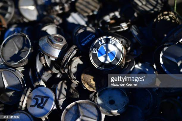 Rim covers for BMW cars are displayed at a scrap yard on March 19 2018 in Hamburg Germany Diesel car owners in Germany are fearing the value of their...