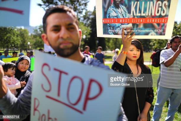 Rima Kamal of Medford right listens to speakers during a rally held by the Burma Task Force on the Boston Common on Sep 23 2017 to protest recent...