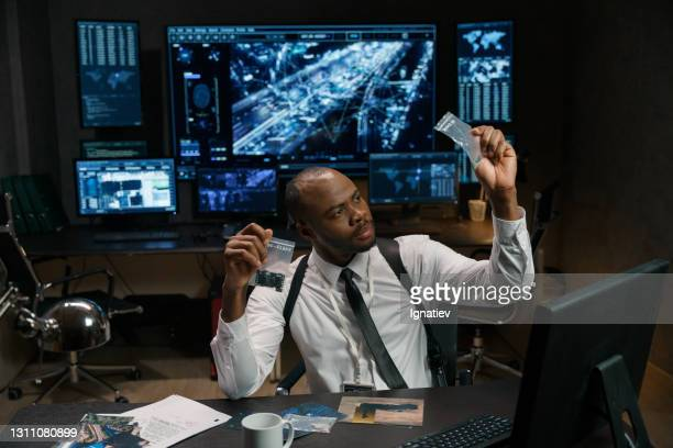 彼の職場のストック写真でсriminologist - 刑事司法 ストックフォトと画像
