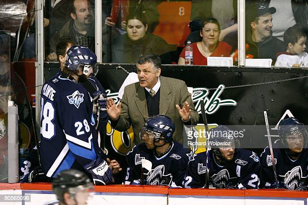 Rimouski Oceanic head coach Clement Jodoin talks to Dave Plante during the game against the Rouyn-Noranda Huskies at Dave Keon Arena on April 05,...