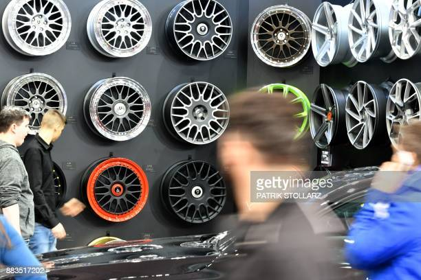 Rims are on display at the 'Essen Motor Show' fair in Essen western Germany on December 1 2017 According to the organisers more than 500 exhibitors...