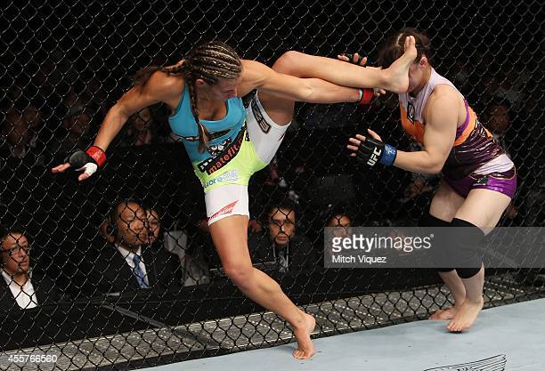 Rin Nakai goes for a takedown on Miesha Tate in their bantamweight bout during the UFC Fight Night event inside the Saitama Arena on September 20,...