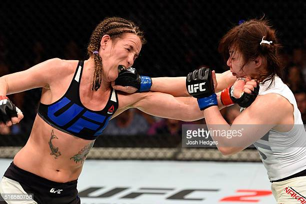 Rin Nakai of Japan punches Leslie Smith of the United States in their women's bantamweight bout during the UFC Fight Night event at the Brisbane...