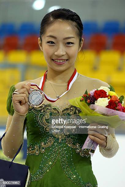 Rin Nitaya of Japan presents the bronze medal during the medal ceremony of the junior ladies competition of the ISU Junior Grand Prix at TorTor Arena...