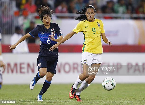 Rin Sumida of Japan tries to tackle Duda of Brazil during the FIFA U20 Women's World Cup Quarter Final match between Japan and Brazil at the National...