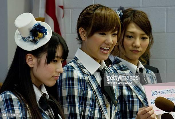 Rina Hirata , Aki Takajo and Sae Miyazawa of Japanese pop group AKB48 interact with children during a visit to Strong John Thomson Elementary school...
