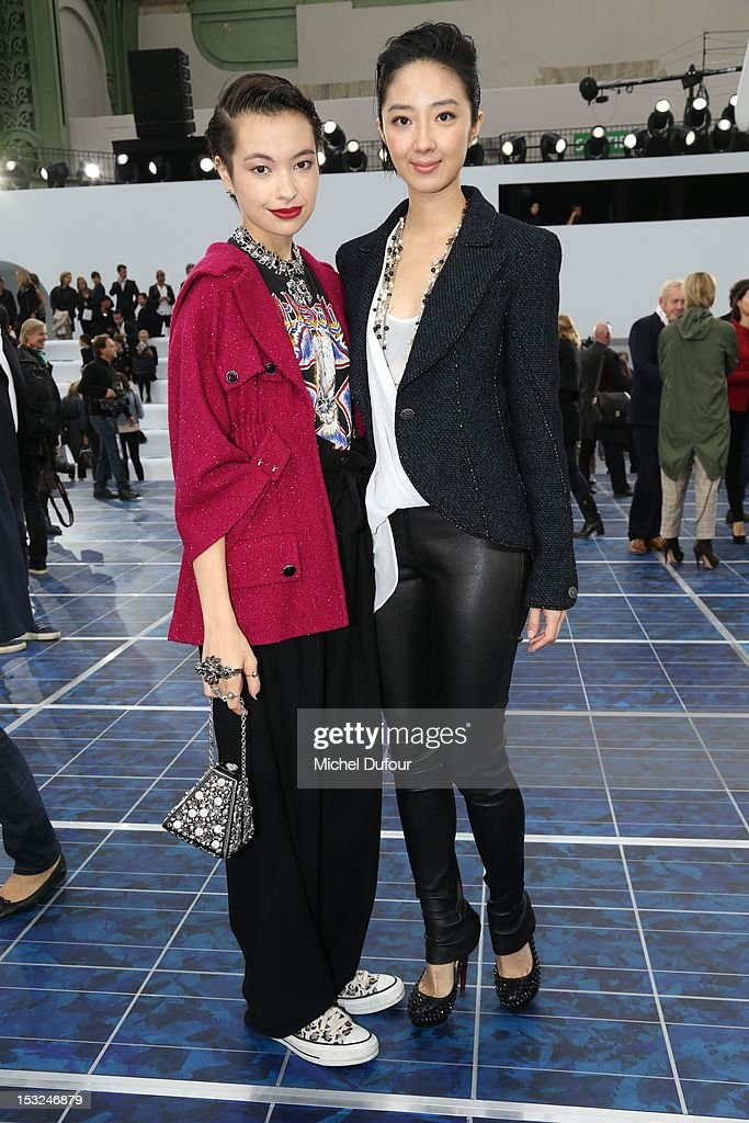 Rina Ota and Lun Mei Guey attend the Chanel Spring / Summer 2013 show as part of Paris Fashion Week at Grand Palais on October 2, 2012 in Paris, France.